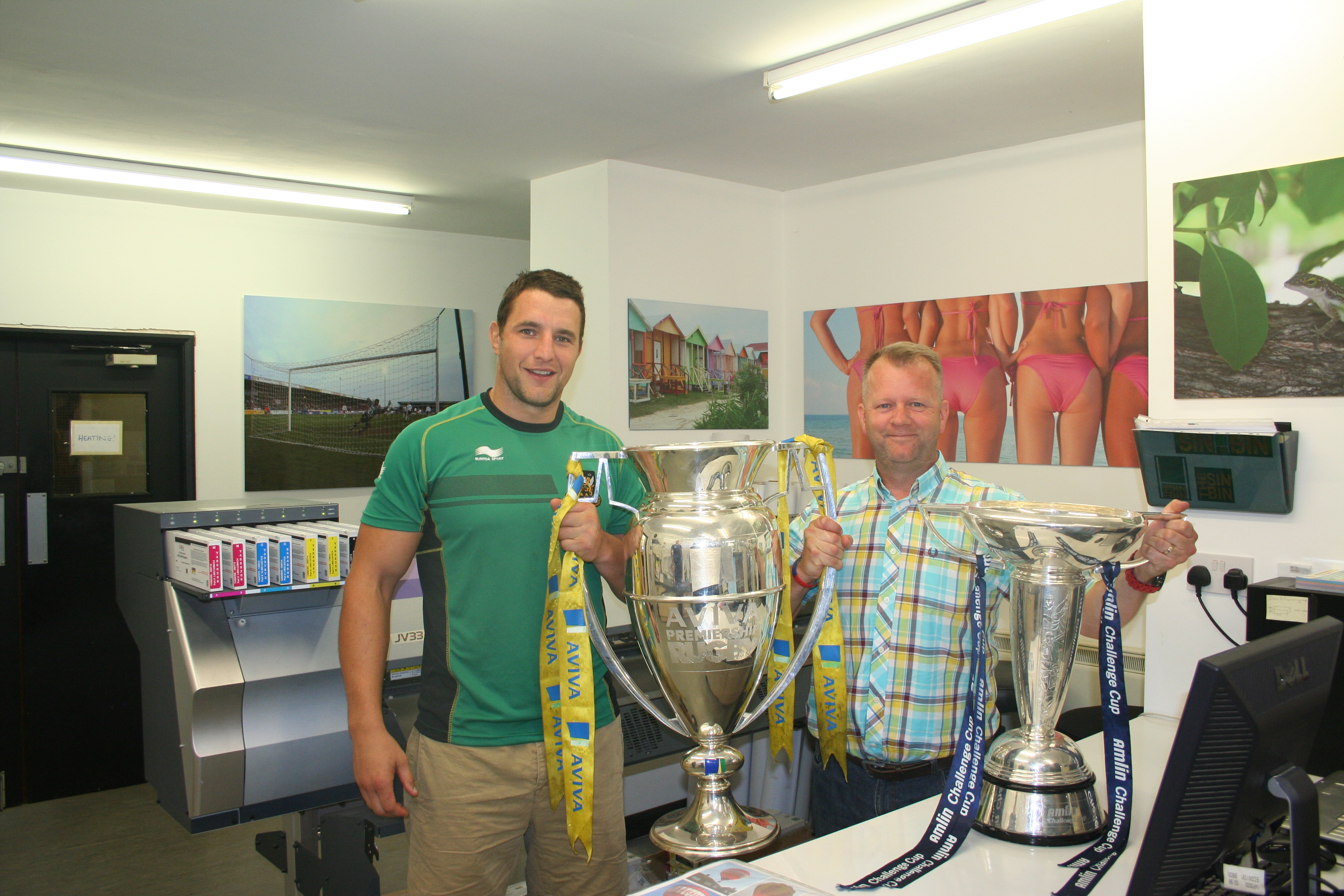 Phil Dowson brings the Trophies To Zedi Signs Limited