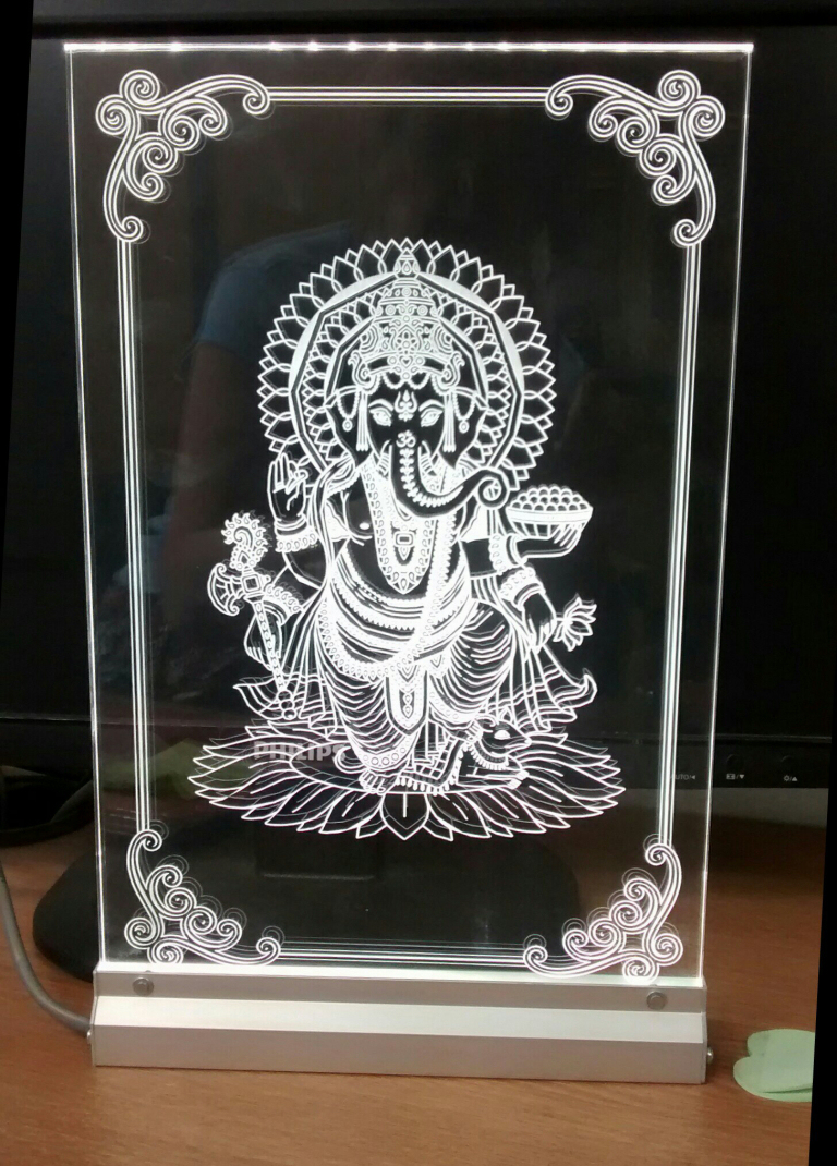 Illuminated engraved display